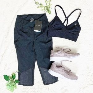 Nike outfit of mesh capris and sports bra.